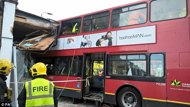 Paramedics were tending to people on the top deck of the number 77 double-decker bus