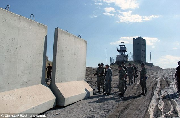 Pictures show huge concrete blocks being moved in to position along the border in Agri province in a bid to halt the infiltration of Kurdish militants and illegal smugglers