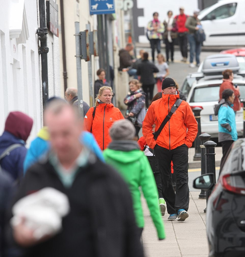 Where the pavements are lined with... people: The rural  island has been experiencing record levels of tourists, as illustrated by this image from Portree
