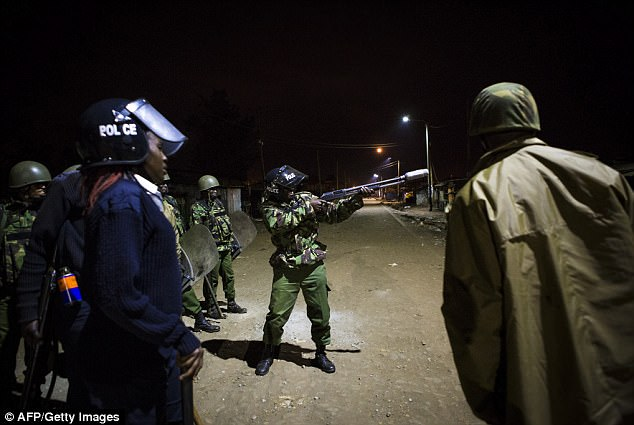 Riot police officers fire tear gas in Kawangware slum in Nairobi. Police and rioters clashed today