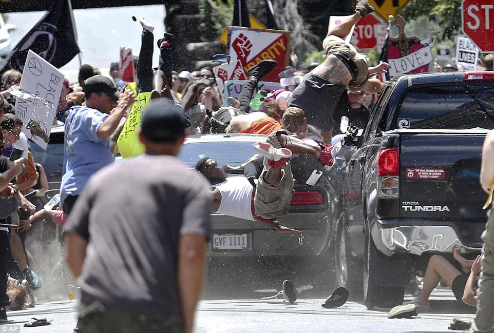 A Dodge Challenger (pictured) intentionally plowed into counter protesters, killing one woman and hospitalizing 19 others, as violence erupted at a rally where thousands of white nationalists gathered for an alt-right event in Charlottesville, Virginia, on Saturday. Police said a total of 35 people were treated for injuries