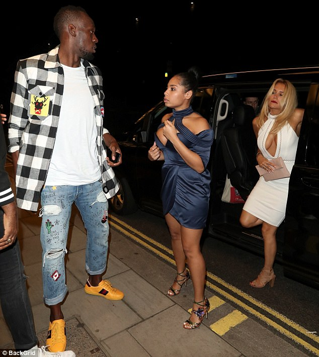 Never-ending celebrations: Bolt took his 'retirement party' into a third night yesterday as he partied with his partner