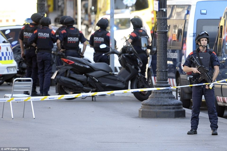 Armed police on the streets of Barcelona following Thursday's atrocity, which saw a van plough into crowds of pedestrians in the city's tourist area