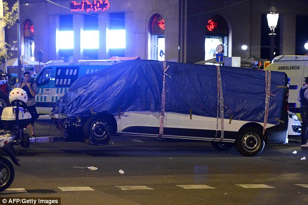 Pictured is the van used in the attack being taken away by police.