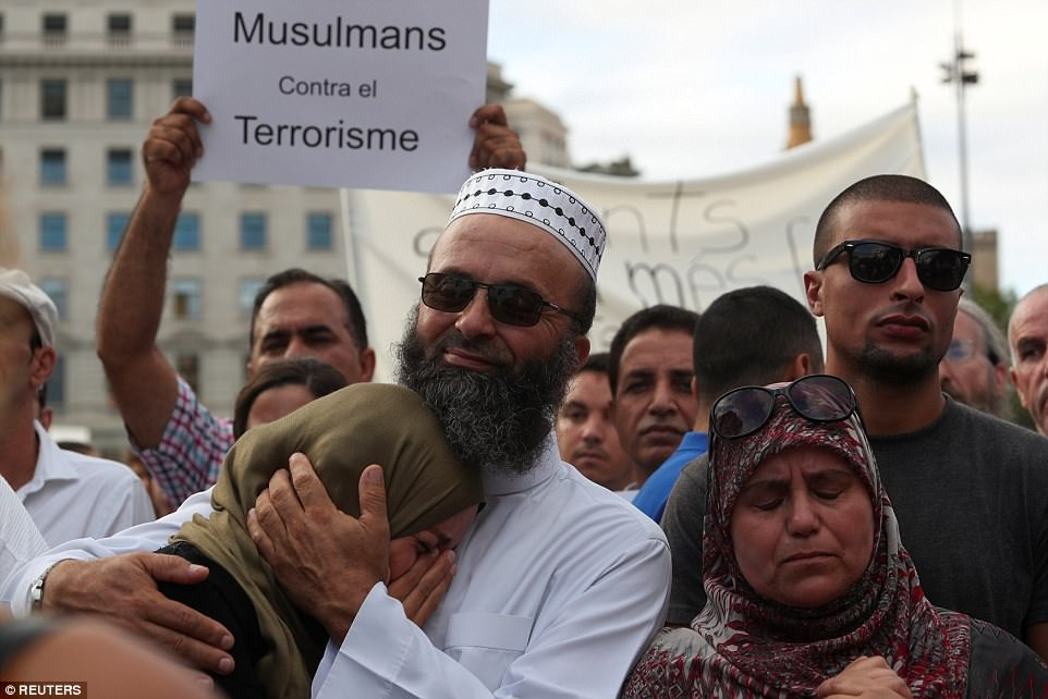 Women were seen crying as the demonstration was being carried out, while others held up posters which said 'Muslims against terrorism'