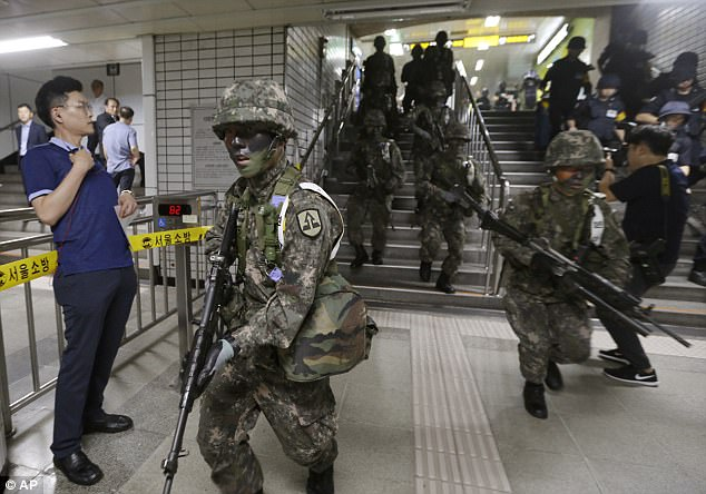South Korean army soldiers conduct an anti-terror drill as part of Ulchi Freedom Guardian exercise inside a subway station in Seoul, South Korea on Tuesday