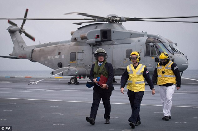 Defence Secretary Sir Michael Fallon (left aboard the HMS Queen Elizabeth last month) said recent terror attacks in Europe served as a 'grim reminder' of the importance of the UK mission