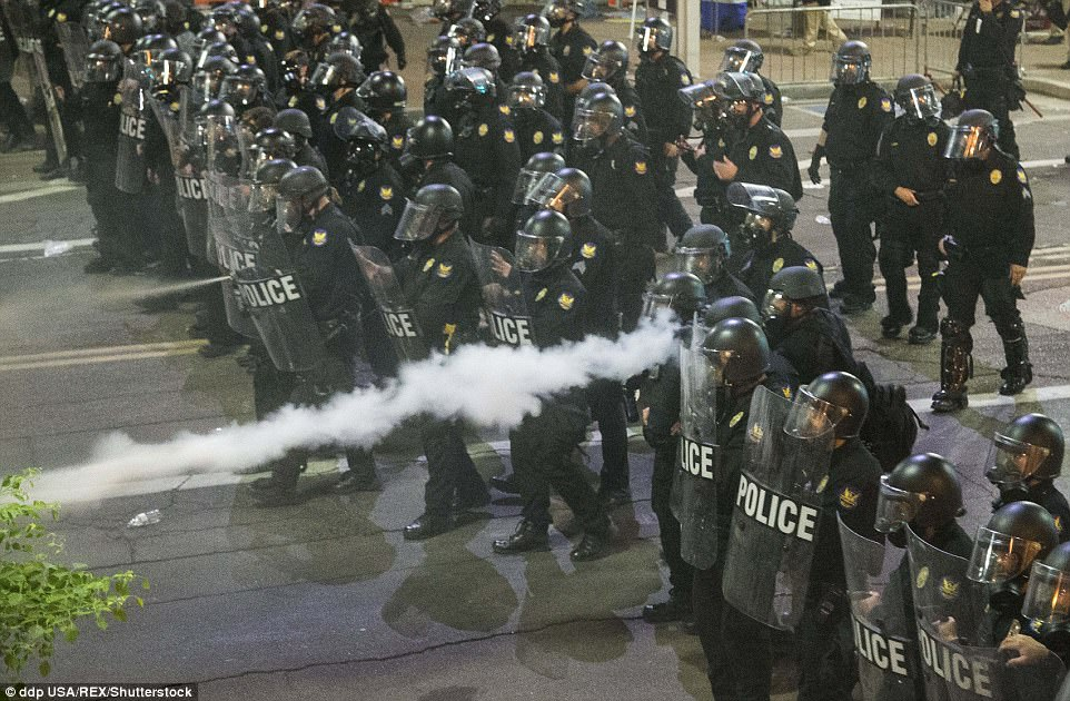 Police say that protesters threw water bottles and rocks at their lines, causing them to respond in kind with tear gas