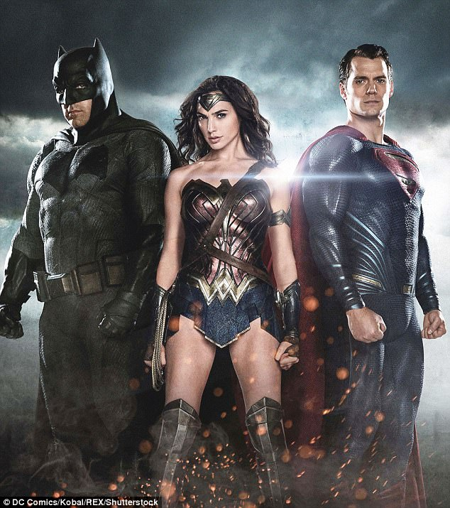 Save the day: Henry's most notorious role as Superman in the movie Justice League will fly into the box office November 17 (pictured with Ben Affleck and Gal Gadot)