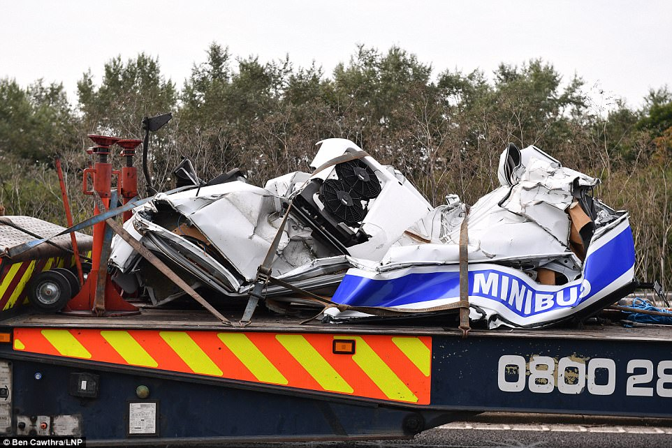 Eight people have died after a minibus, pictured above, was 'squashed flat' after a crash with two lorries on the M1 today