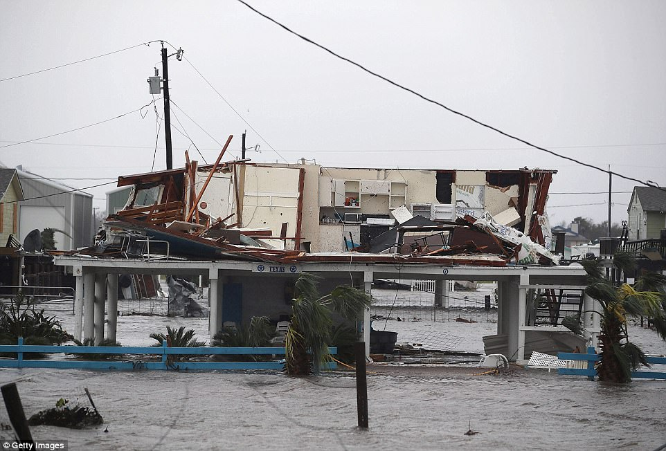 Rockpot Mayor Charles Wax said the city's emergency response system had been hampered by the loss of cellphone service and other forms of communication. Pictured: A damaged home is seen after Hurricane Harvey passed through Rockport
