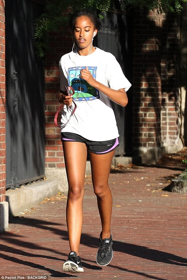 Barack and Michelle Obama's first-born reacted angrily Saturday to a gawker who waited outside a campus store in order to snap a picture of the famous former occupant of the White House. Malia is seen going for a run this past Wednesday in Harvard Square
