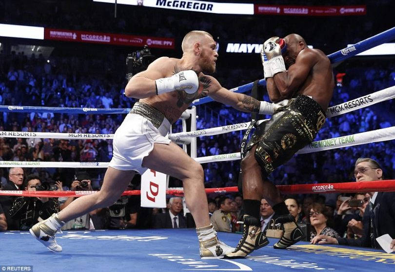 McGregor forces Mayweather onto the ropes during the opening round of theirsuper-welterweight clash in Las Vegas