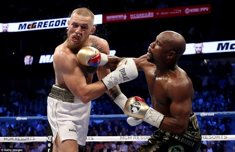 Mayweather lands a lovely right-handed punch which McGregor feels the full force of at Las Vegas' T-Mobile Arena
