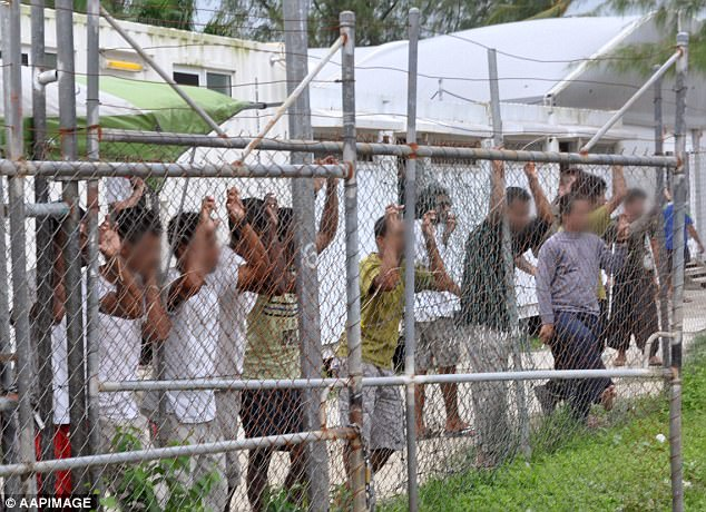 The Federal government is pushing to cut welfare payments to hundreds of asylum seekers who came to Australia to receive medical treatment. Pictured, asylum seekers at Manus Island in 2014