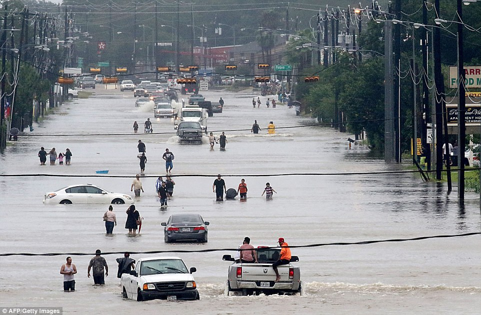 Residents in Houston abandoned their cars after becoming stuck in flood waters on Telephone Road on Sunday afternoon