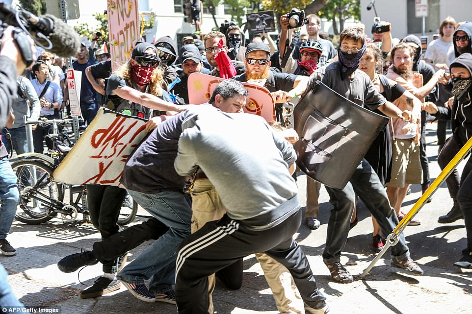 No-To-Marxism rally members and counter protesters clash on Sunday in Berkeley, California