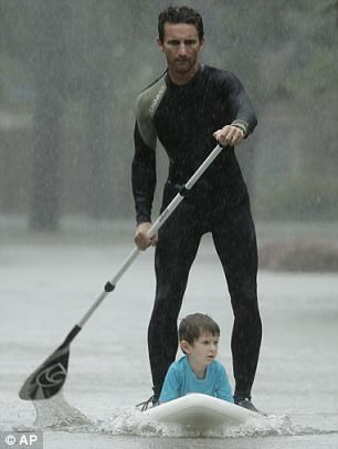 Jorge used his might to paddle the boy to safety as flood water rose around them