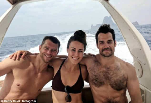 Picture perfect: Henry Cavill, 34, cosied up with his stuntwoman love, Lucy Cork, 25, as they made the most of the last days of summer during a romantic boat ride on Wednesday
