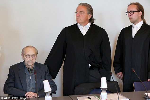 Former SS medic Hubert Zafke (left), 95, accused of aiding in 3,681 murders in Auschwitz in 1944, sits next to his lawyers Peter-Michael Diestel (centre) and Hannes Barck as he arrives for his trial on September 12, 2016 at the court in Neubrandenburg, northeastern Germany