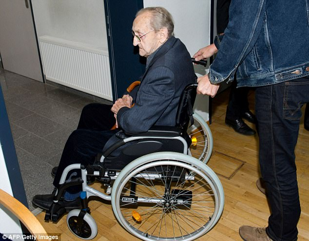 Hubert Zafke, 95, is wheeled out of court after yet another postponement in his trial