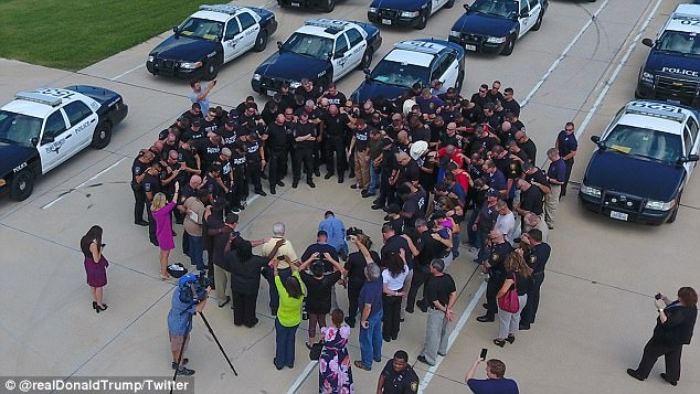 Following the announcement that he and his wife would donate $1 million to Hurricane Harvey relief, Trump tweeted a photo of those who first responded and who were gathered in a prayer circle. A man is seen praying on his knees in the middle