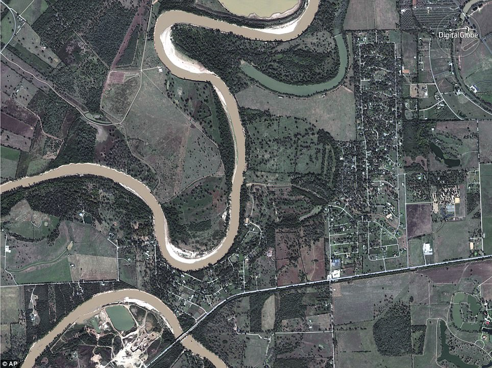 Before on November 20: Simonton, Texas, was completely overtaken by flood waters