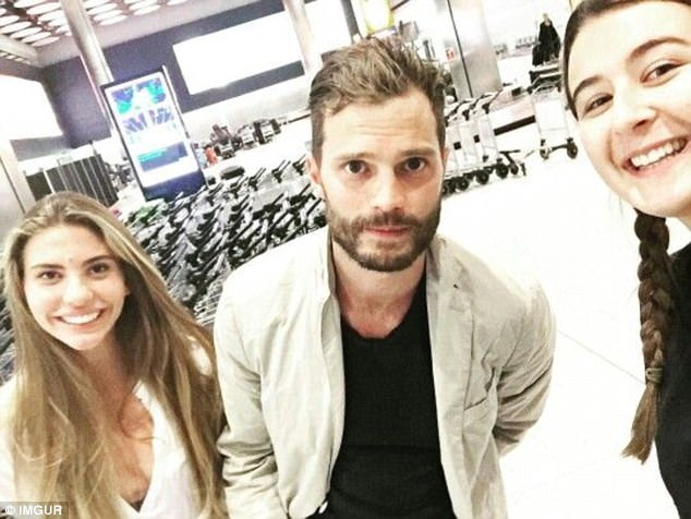 Fifty Shades of Grey star Jamie Dorman ducked into this snap while waiting at the baggage reclaim