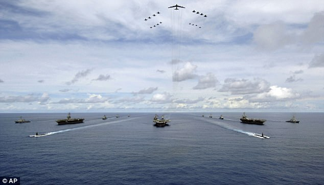 The American military has a huge presence in the area – with an estimated 40,000 personnel in Japan and 35,000 in South Korea, while using the island of Guam as a 'permanent aircraft carrier'. Pictured: US Navy ships and planes off GUam