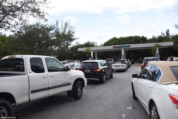 Floridians have been waiting in long lines to fill up on gas before the storm hits. Above, a line for gas at a Costco in North Miami, Florida on tuesday