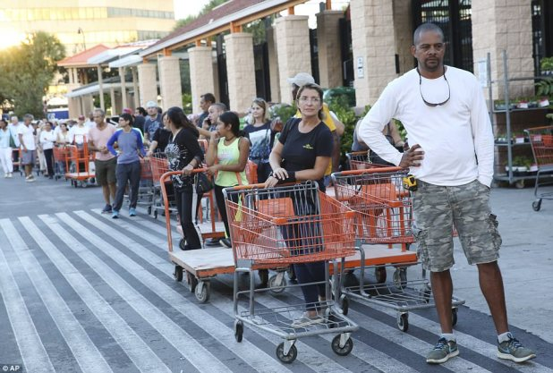 Eduardo Soriano of Miami, waits in a line since dawn to purchase plywood sheets at a Home Depot store in North Miami, Florida on Wednesday