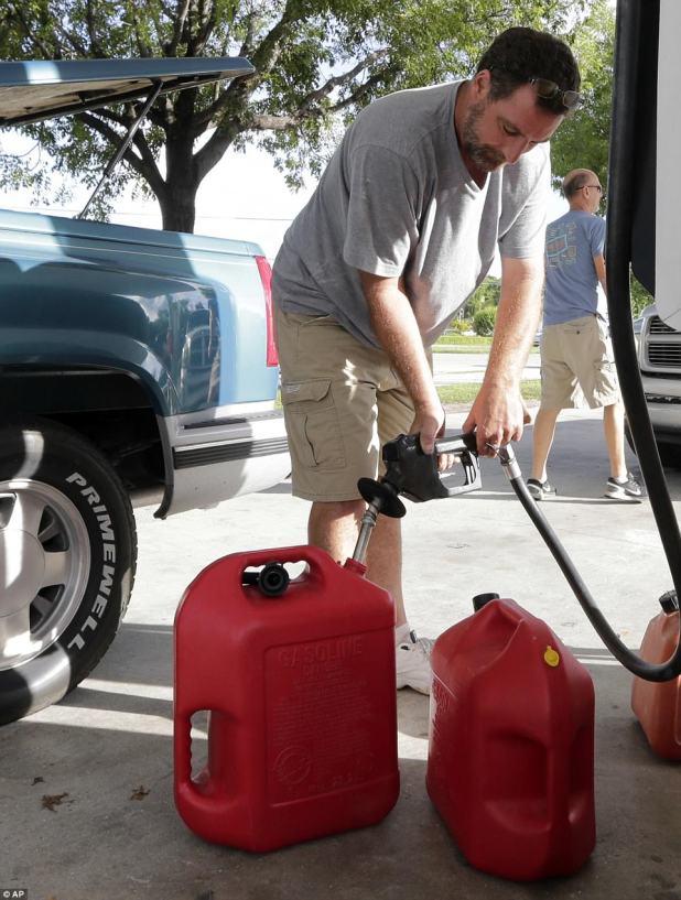Anthony Mirto fills tanks as he prepares for Hurricane Irma on Wednesday in Key Largo, Florida