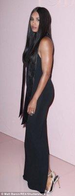 The 31-year-old wore a black dress to the high fashion event, where she mingled with celeb pals like Kim Kardashian