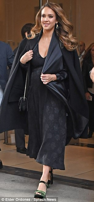 Mom on the run: The Fantastic Four star draped an elegant black wool coat over her shoulders, while adding height to her frame with a pair of jade green suede strappy heels