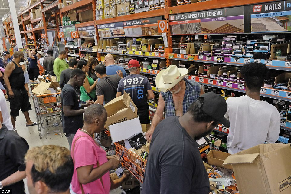 Customers at a Home Depot in South Miami Dade buy building materials to secure their property in anticipation of Hurricane Irma early Friday, Sept. 8, 2017 in Miami, Florida