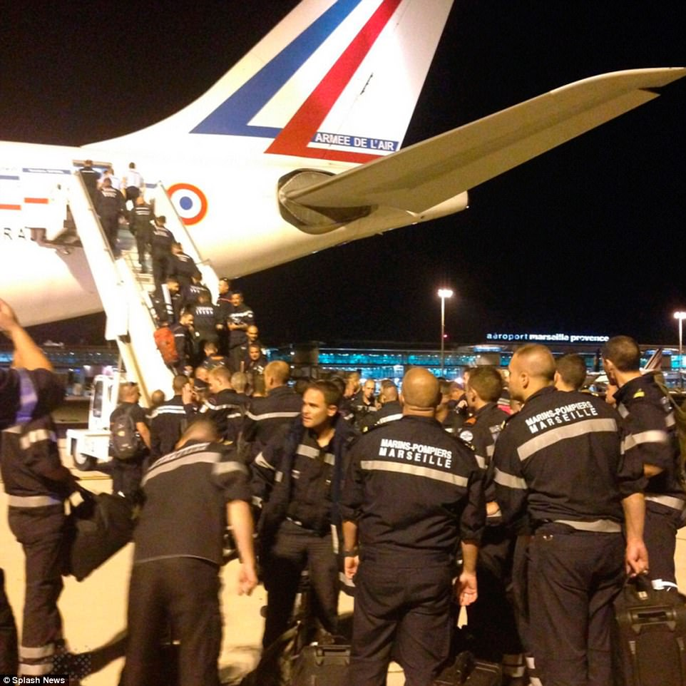 Marine firefighters from the French city of Marseille board a plane to help the storm ravaged French Caribbean