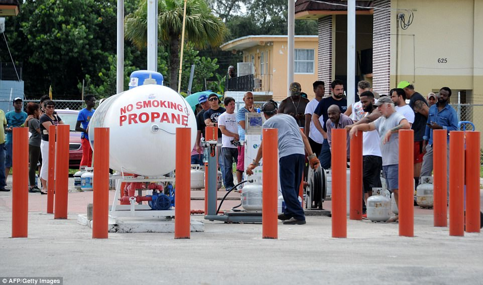 People line up to refill propane during preparations for hurricane Irma in Miami, Florida on Friday