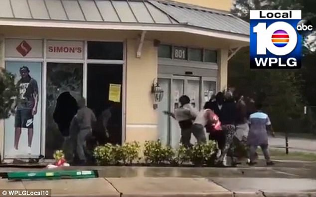At least eight people were filmed by a local ABC camera crew breaking into Simon's Sportswear in Fort Lauderdale