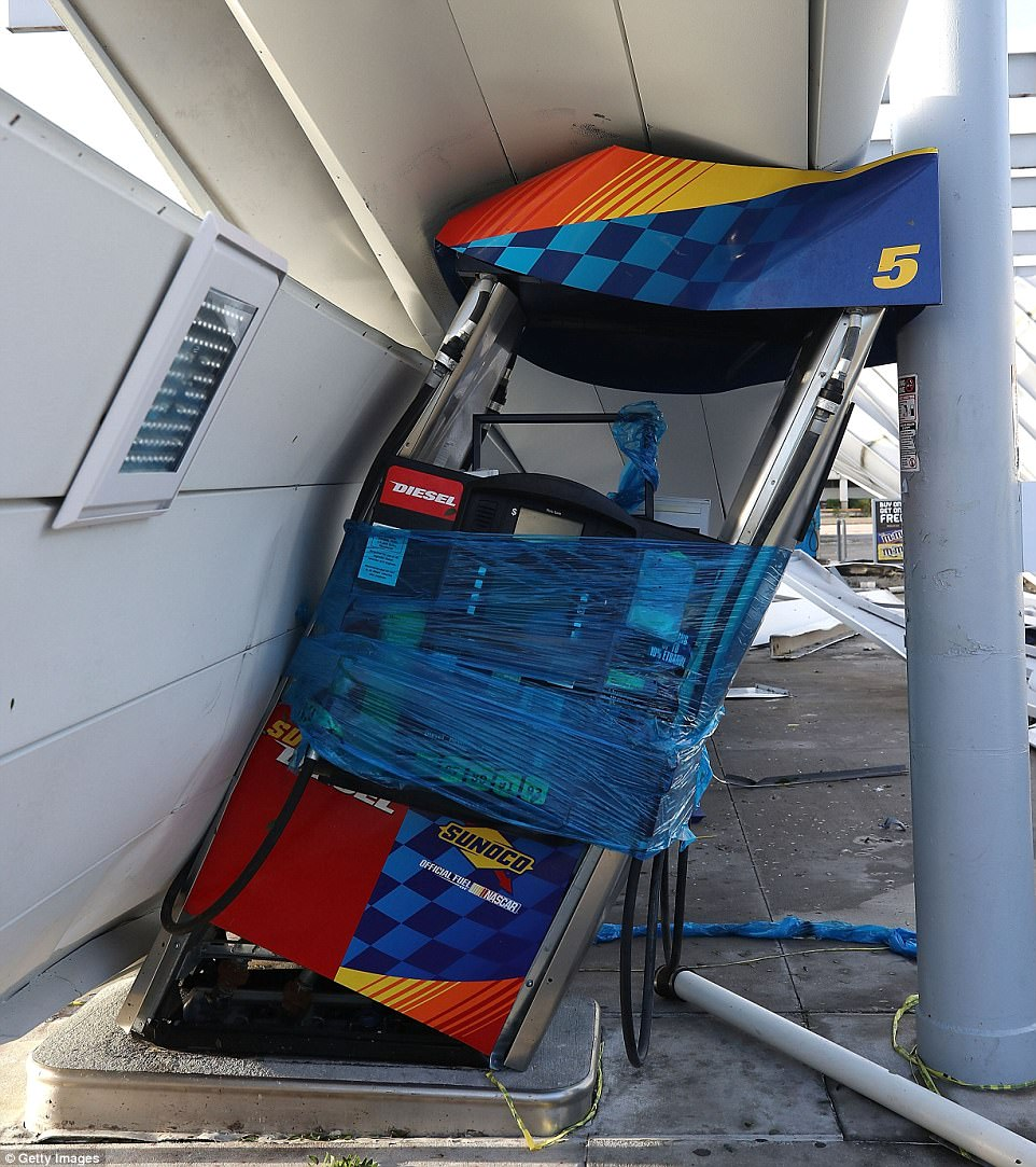 A gas station is shown damaged by Hurricane Irma winds on September 11, 2017 in Bonita Springs, Florida