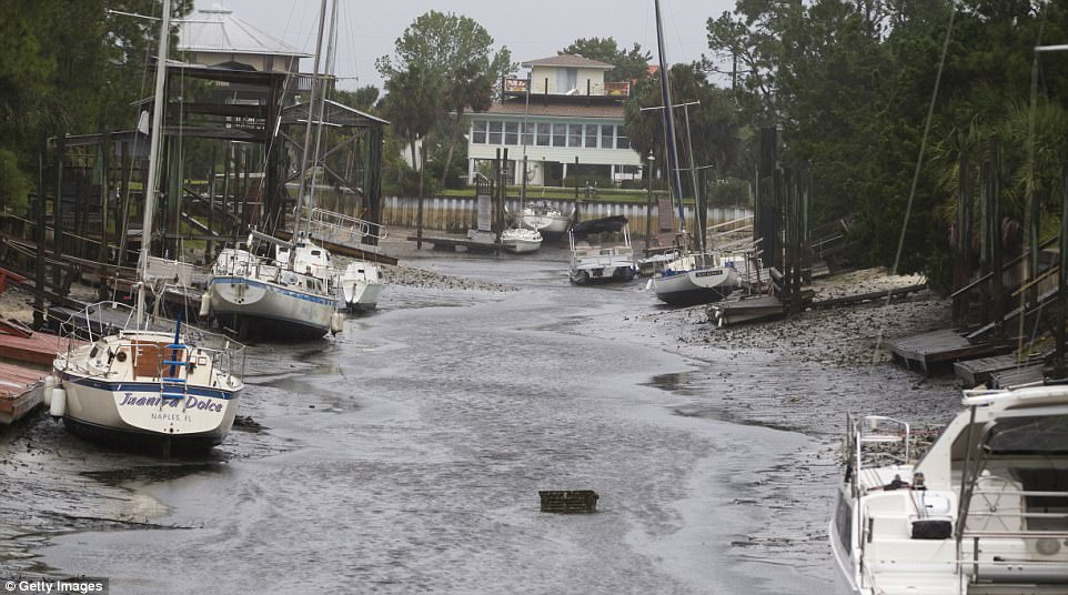 Boats sit on the bottom in the north Florida panhandle community of Shell Point Beach as Hurricane Irma pulls the water out September 11, 2017 in Crawfordville, Florida