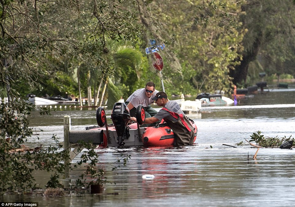 Members of the Bonita Springs Fire Department set off to survey damage in a flooded neighborhood in Bonita Springs, Florida, northeast of Naples, on September 11, 2017 after Hurricane Irma hit Florida