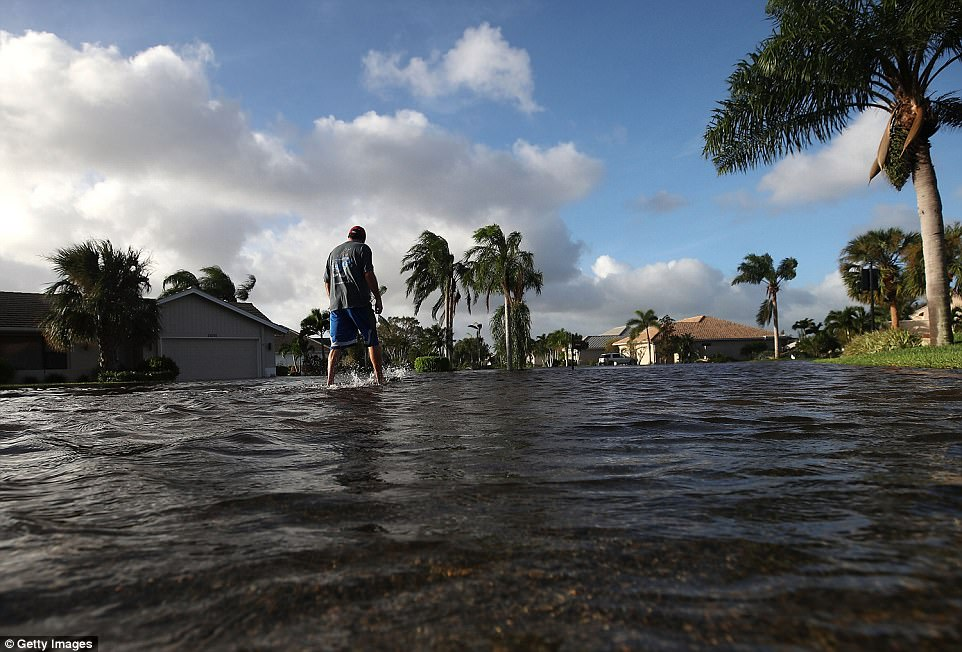 A man walks through Hurricane Irma floodwaters on Monday in Bonita Springs, Florida