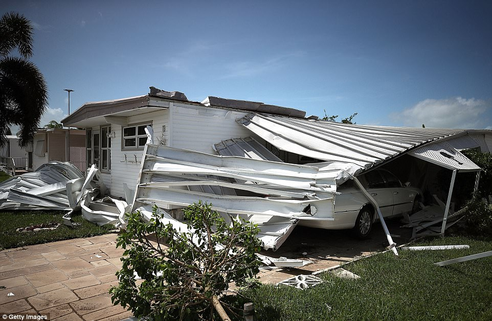A home is shown damaged after Hurricane Irma hit the area on September 11, 2017 in East Naples, Florida