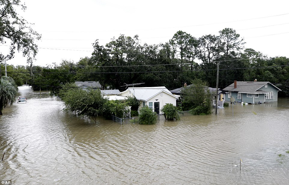 Water rises in a neighborhood after Hurricane Irma brought floodwaters to Jacksonville, Florida Monday, September 11, 2017