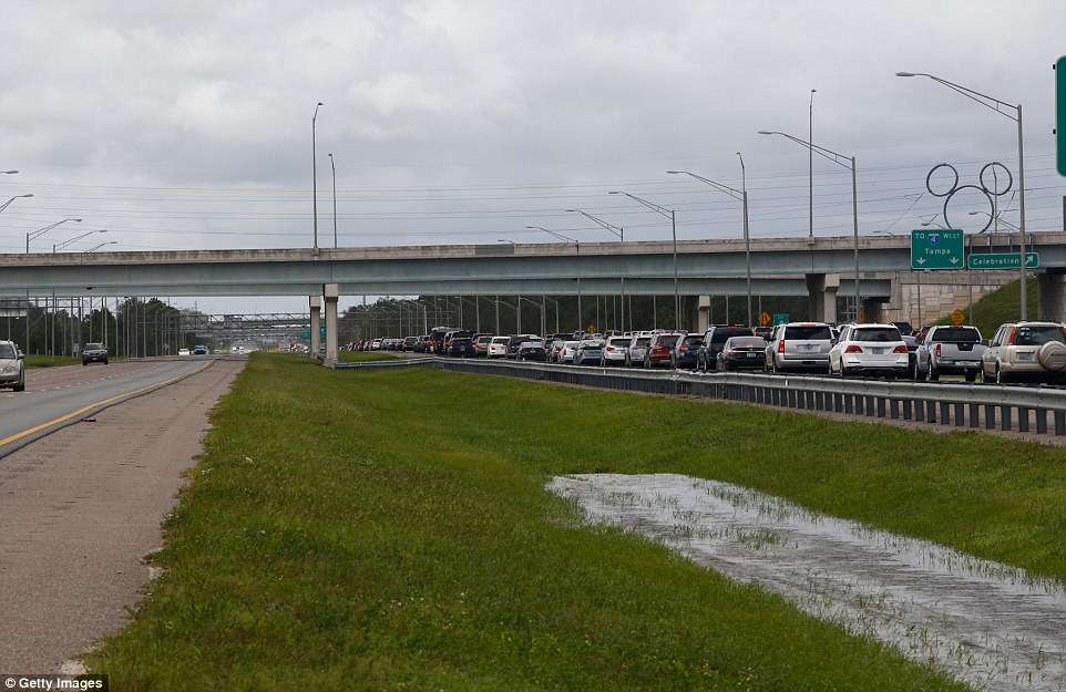 Heavy westbound traffic comes to a stop at a back up on I-4 near the Celebration exit as Florida residents attempt to make their way back home after evacuating Hurricane Irma on September 11, 2017 in Lake Buena Vista, Florida