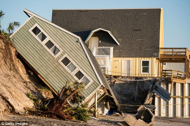 A beachfront home shows damage from Hurricane Irma on September 13, 2017 in Vilano Beach, Florida. Nearly 4 million people remained without power more than two days after Irma swept through the state