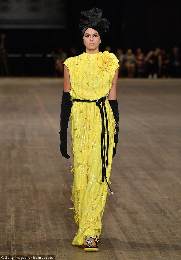 It girl: Cindy Crawford and Rande Gerber's daughter Kaia, 16, has been in great demand during New York Fashion Week and strutted her stuff in a canary yellow gown for Marc Jacobs