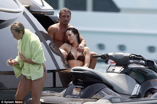 John Ibrahim and girlfriend Sarah Budge, a Kings Cross bar owner and model, pictured enjoying a day by the sea in Ibiza while on holiday with Kyle Sandilands and Imogen Anthony