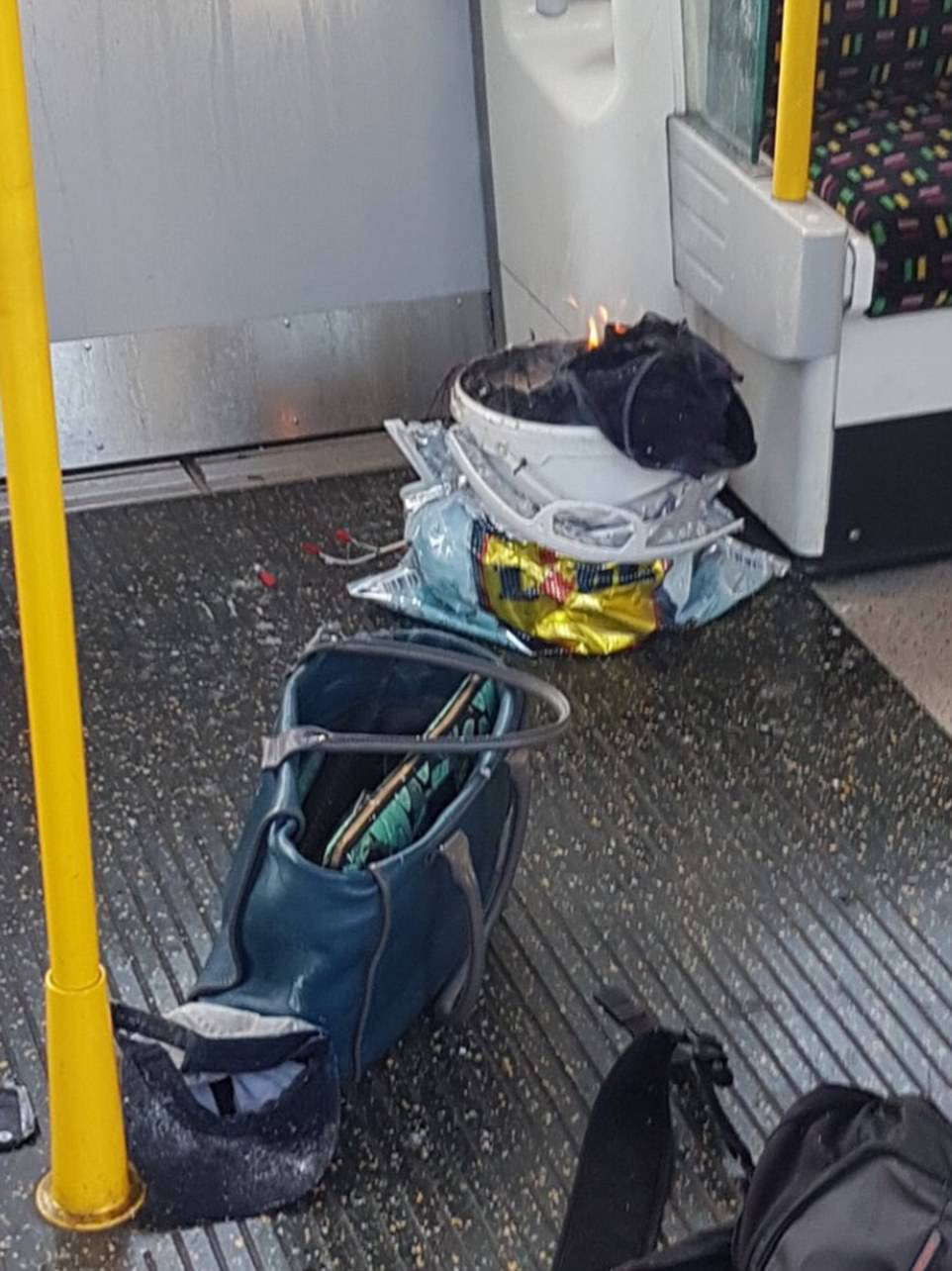 Photographs on social media show a bucket alight on the underground train and hidden inside a Lidl cool bag