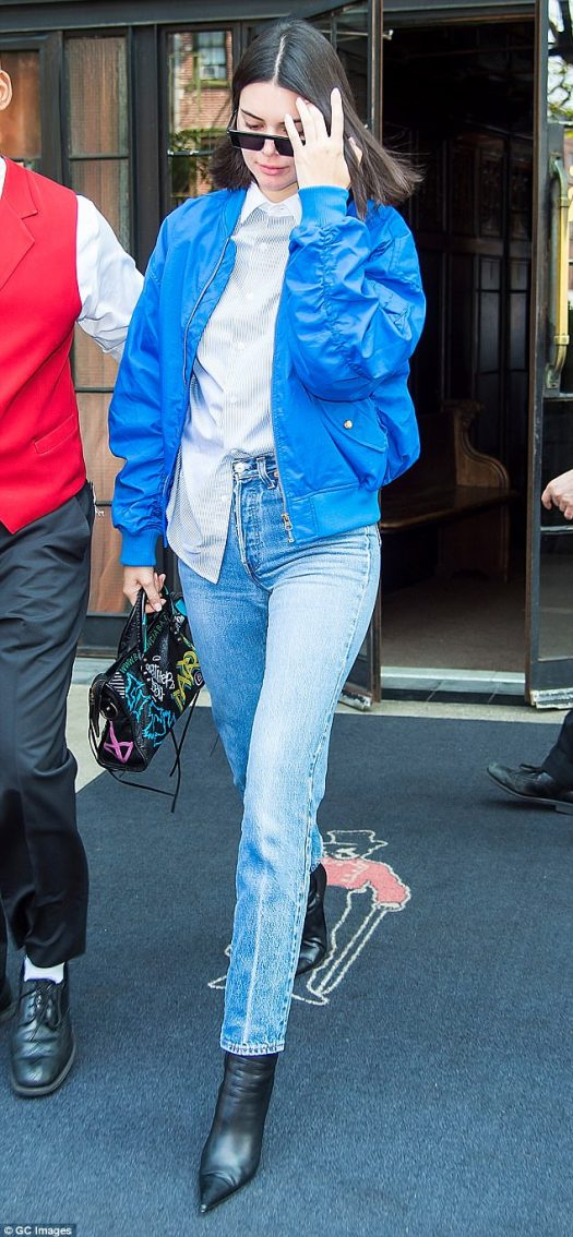 Model behavior: Kendall Jenner, 21, hit the streets of New York City in a tailored button down with a Fiorucci bomber jacket layered on top